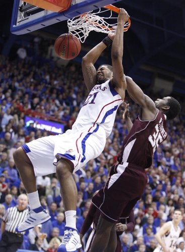 Kansas forward Markieff Morris delivers a dunk before Texas A&M forward Ray Turner during the second half on Wednesday, March 2, 2011 at Allen Fieldhouse.