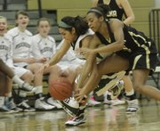 Free State's Jackie Garcia scrambles for a loose ball against Topeka High in a sub-state tournament game Thursday, March 3, 2011 at FSHS.