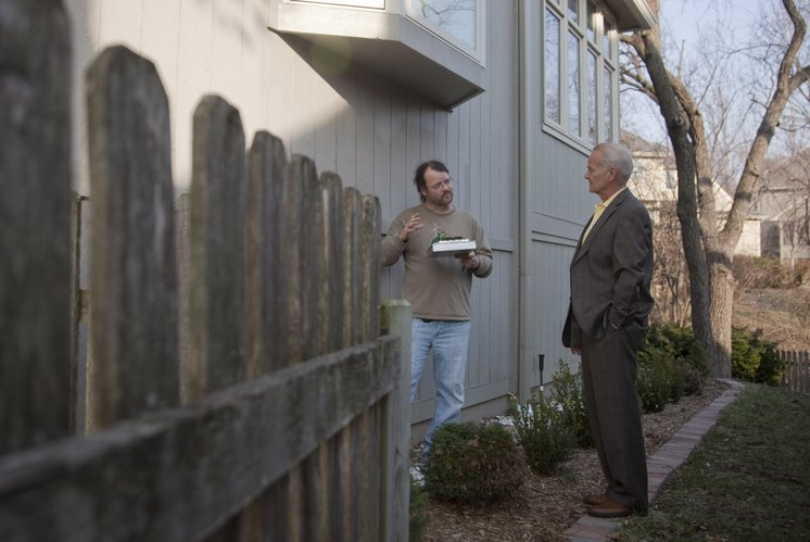 Robert Coffman, with AirTight Energy Audits, talks to homeowner Tony Schmidt about his home's energy loss and ways to fix the problem. The audit, which was done March 3, is one way Lawrence residents can participate in the Take Charge Challenge.