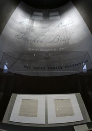 "James Naismith&squot;s original rules of ""Basket Ball"" are displayed at the Nelson-Atkins Museum of Art on Friday, March 4, 2011, in Kansas City, Mo. David Booth and family purchased the rules at a Sotheby&squot;s auction for more than $4 million; after the museum display, the rules will be shown at the University of Kansas."