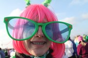 Dressed to run, Madison Fowler, 14, Lawrence, sports a pair of green sunglasses for fun Saturday at the Shamrock Shuffle. About 400 runners participated in the annual 5K run that helps raise money for area charities.