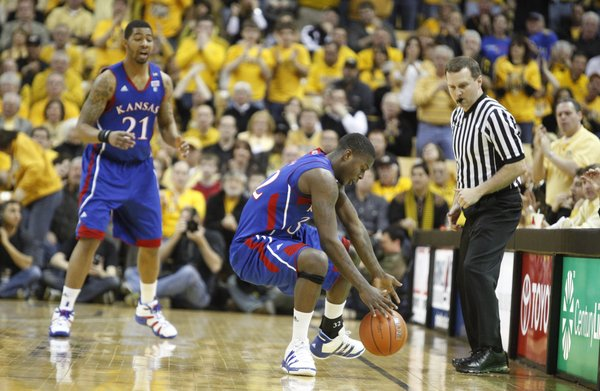 Kansas forward Markieff Morris (21) and a game official watch as Josh Selby loses the ball out of bounds for a turnover against Missouri during the first half on Saturday, March 5, 2011 at Mizzou Arena.
