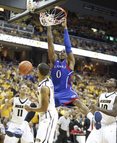 Kansas forward Thomas Robinson finishes a put-back dunk over Missouri forward Laurence Bowers during the second half on Saturday, March 5, 2011 at Mizzou Arena.