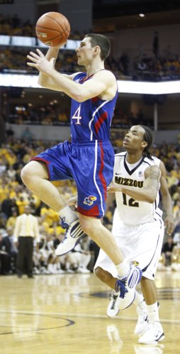 Kansas guard Tyrel Reed puts up a floater past Missouri guard Marcus Denmon during the second half on Saturday, March 5, 2011 at Mizzou Arena.