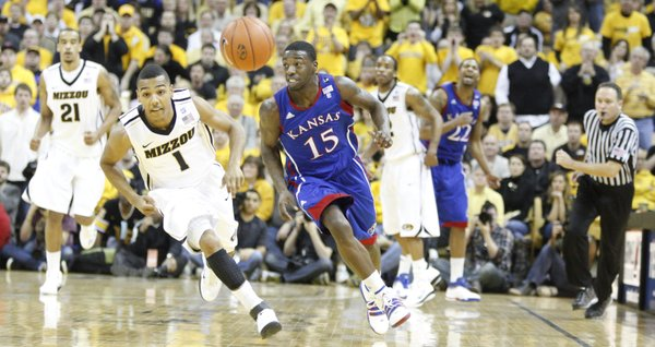 Kansas guard Elijah Johnson and Missouri guard Phil Pressey chase down a loose ball during the second half on Saturday, March 5, 2011 at Mizzou Arena.