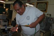 David Salazar, Santa Cruz, Calif., uses a torch technique to mold a marble during his demonstration Friday at Marble Crazy in Bonner Springs.