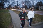 Ellen Young, left, organizes and helps raise funds for runs in Lawrence, including a weekly women's running group.