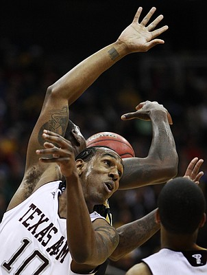 Texas A&M forward David Loubeau (10) battles for a rebound against Missouri forward Ricardo Ratliffe, back, during the first half of a Big 12 tournament in Kansas City, Mo., in this March 2011 file photo.