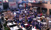 Big 12 basketball fans fill the live block at KC's Power & Light district before tipoff of the KU-OSU game.