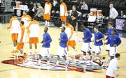 The Kansas guards get loose at mid-court prior to tipoff against Oklahoma State in the Big 12 tournament on Thursday, March 10, 2011 at the Sprint Center in Kansas City.