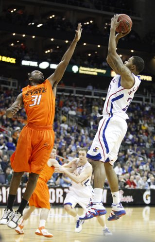 Kansas forward Marcus Morris shoots over Oklahoma State forward Matt Pilgrim during the first half on Thursday, March 10, 2011 at the Sprint Center in Kansas City.