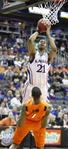 Kansas forward Markieff Morris puts up a shot as Oklahoma State forward Jarred Shaw is called for a blocking foul during the first half on Thursday, March 10, 2011 at the Sprint Center in Kansas City.