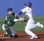 Kansas runner Jimmy Waters, (7) right, is thrown out at home against Eastern Michigan Friday, March 11, 2011. It was the second time in three innings that Waters had reached base only to be thrown out at home.