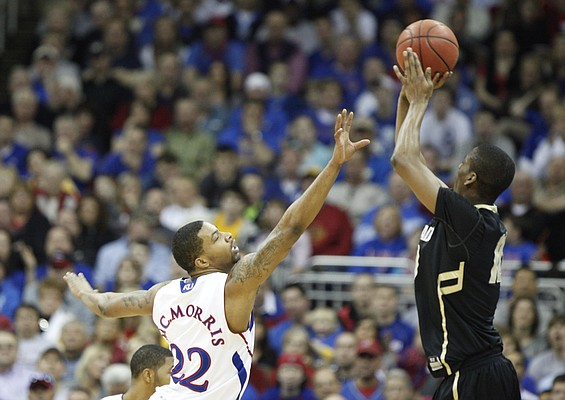Kansas forward Marcus Morris defends a shot by Colorado guard Alec Burks during the first half on Friday, March 11, 2011 at the Sprint Center.