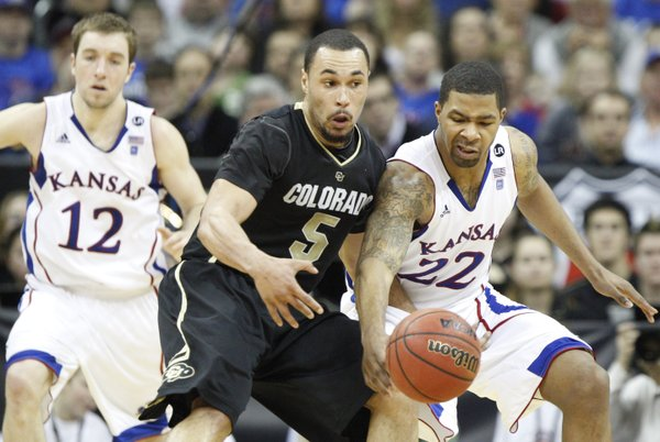 Kansas forward Marcus Morris strips the ball from Colorado forward Marcus Relphorde during the second half on Friday, March 11, 2011 at the Sprint Center. At left is KU guard Brady Morningstar.