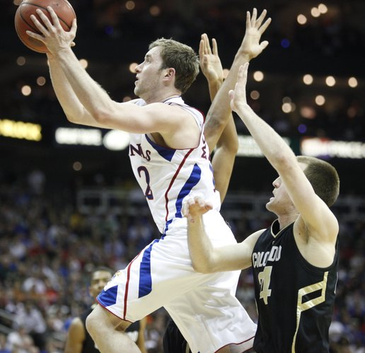 Kansas guard Brady Morningstar elevates past Colorado guard Levi Knutson for a bucket during the second half on Friday, March 11, 2011 at the Sprint Center.