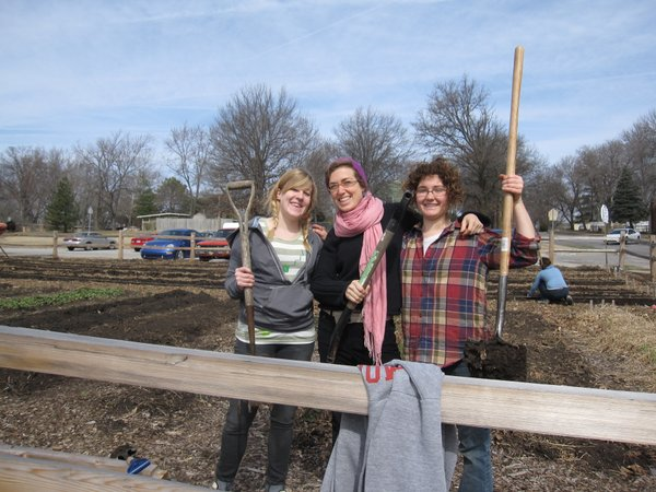 From left are Kelly Kearns, Rachael Perry and Sally Birmingham, all employees of The Merc. They volunteered Saturday, March 12, 2011, to work in the school garden at West Junior High School.