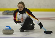 Kansas University graduate student Anne-Christine Barthel practices curling with the Kansas City Curling Club at the Line Creek Community Center in Kansas City, Mo. Barthel is a member of the German national curling team. Many players in this area are from other countries, but Midwesterners participate in the sport also.