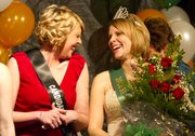 Lacey Henry, right, and Erin Taylor, both from Lawrence, share a laugh following the coronation of the 2011 St. Patrick's Day Parade Queen Sunday, March 13, 2011 at The Flamingo Club in North Lawrence. Henry was crowned queen of the 2011 parade.