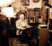 Jim Seaver surrounded by his opera collection at his home on Louisiana and Sixth Street.