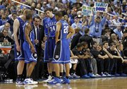 Coach Mike Krzyzewski, center, Directs the Blue Devils against North Carolina in the championship game of the 2011 ACC tournament in Greensboro, N.C.