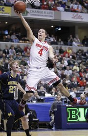 Ohio State guard Aaron Craft (4) goes up for a layup in the first half of a Big Ten tournament game against Michigan.