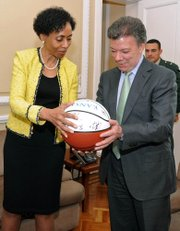 Kansas University Chancellor Bernadette Gray-Little presents an autographed basketball to Colombian President and KU alumnus Juan Manuel Santos during a visit at the Presidential Palace in Bogota, Colombia, Thursday March 17, 2011.