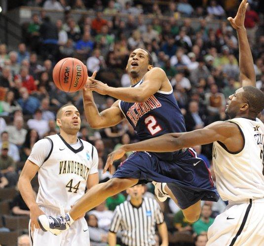 Richmond's Cedrick Lindsay, center, takes a shot against Vanderbilt during a Southwest regional second round NCAA tournament college basketball game, Thursday, March 17, 2011, in Denver.