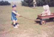 Tyrel Reed, pulling his sister, Lacie, in a wagon.