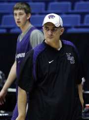 Kansas State coach Frank Martin watches his team during a practice on Wednesday in Tucson, Ariz. The Wildcats will face Utah State approximately 8:57 tonight in Tucson.