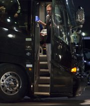 Kansas coach Bill Self exits the team bus after arriving at the Renaissance Hotel on Wednesday in Tulsa, Okla.