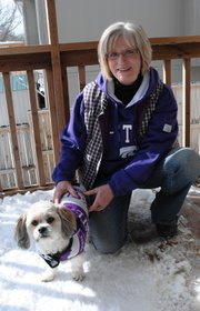 Barbara McPherson, Shawnee, and her shih tzu, Boomer. McPherson recently started Boomeroos, which sells custom-made collegiate fleece jackets for dogs.