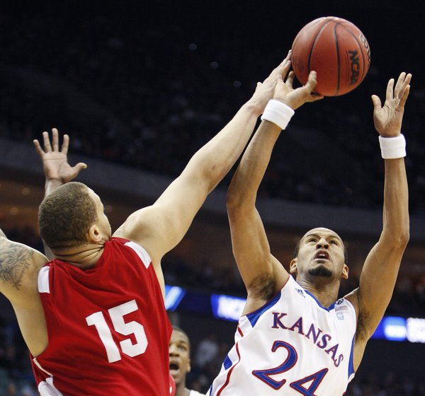 Boston University forward Dom Morris tips the ball away from Kansas guard Travis Releford in the first half of a Southwest Regional NCAA tournament second round college basketball game, Friday, March 18, 2011 in Tulsa, Okla.