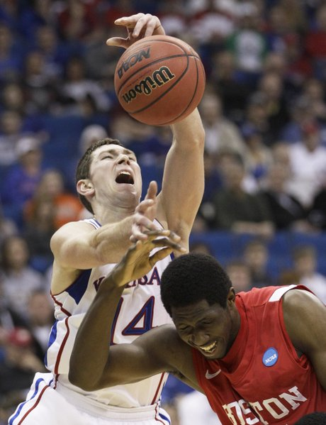 Kansas guard Tyrel Reed and Boston University forward Patrick Hazel battle for a rebound in the first half of a Southwest Regional NCAA tournament second round college basketball game, Friday, March 18, 2011 in Tulsa, Okla.