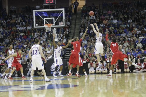 Tyrel Reed shoots a three-pointer over the Boston University defense Friday, March 18, 2011 at the BOK Center in Tulsa.