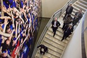 A group of Armenian police officers descend the stairs at the Anderson Family Football Complex during a tour Friday in Lawrence that included Memorial Stadium at Kansas University.