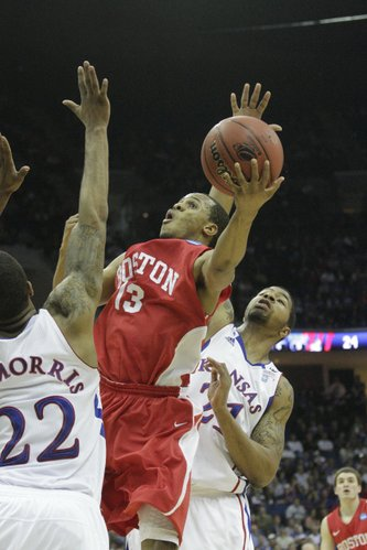 Boston University's D.J. Irving splits Kansas defenders Marcus (22) and Markieff Morris on Friday, March 18, 2011 at the BOK Center in Tulsa.
