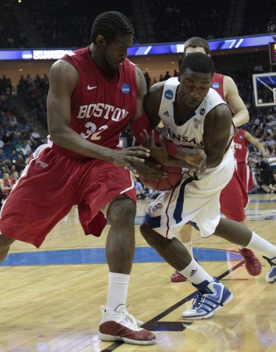Elijah Johnson, (15) right, strips the ball away from Jeff Pelage (32) during the first half against Boston University, Friday, March 18, 2011 at the BOK Center in Tulsa, OK.