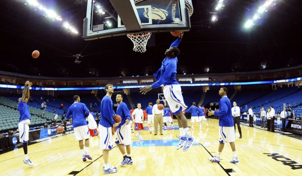 The Kansas big men warm up in the paint prior to the Jayhawks' second-round game against Boston University on Friday, March 18, 2011 at the BOK Center in Tulsa.