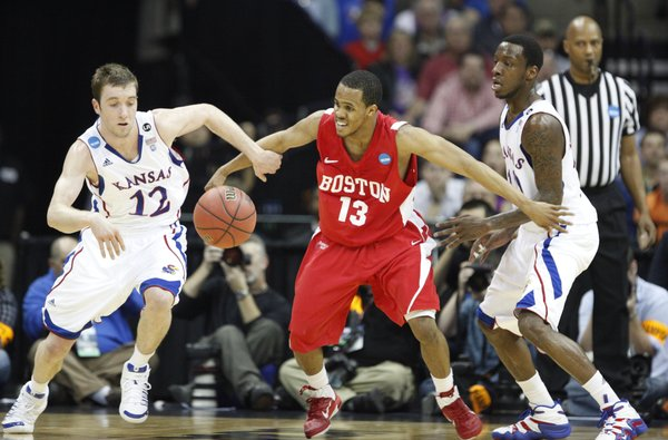 Kansas guard Brady Morningstar steals the ball from Boston University guard D.J. Irving during the first half on Friday, March 18, 2011 at the BOK Center in Tulsa. At right is KU guard Tyshawn Taylor.