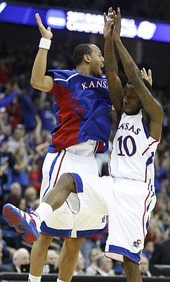 Kansas teammates Travis Releford, left, and Tyshawn Taylor collide in midair as they celebrate a run by the Jayhawks against Boston University during the second half on Friday, March 18, 2011 at the BOK Center in Tulsa.