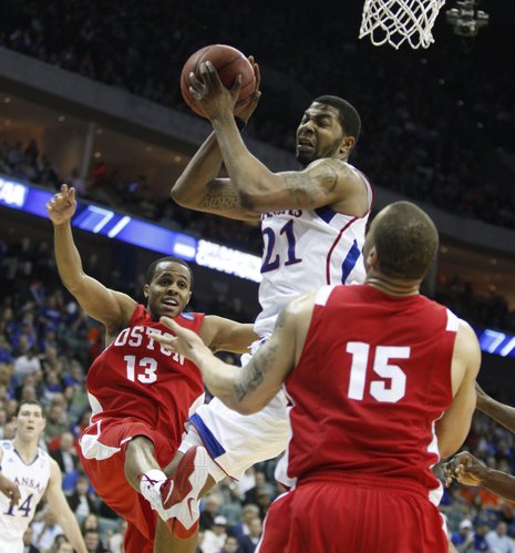 Kansas forward Markieff Morris battles for a rebound between Boston University defenders D.J. Irving (13) and Dom Morris (15) during the first half on Friday, March 18, 2011 at the BOK Center in Tulsa.