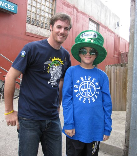 Trevor LaFarge, left, poses for a picture with Isaac Greenly, a cancer survivor, during a St. Baldrick's Foundation fundraiser Saturday, March 19, 2011, behind Dempsey's Burger Pub in downtown Lawrence. LaFarge organized the event which benefits childhood cancer research.