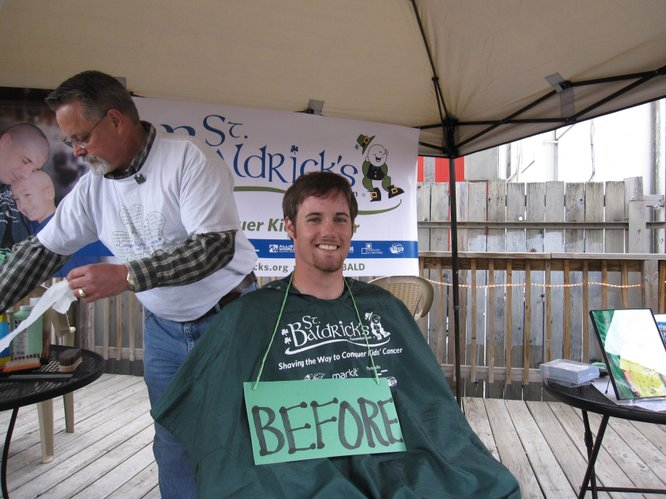 Trevor LaFarge, 20, a Washburn University student, is ready to have his head shaven during the St. Baldrick's Foundation fundraiser Saturday, March 19, 2011, in downtown Lawrence. LaFarge organized the event, which raises awareness about childhood cancer and money for research. This is his sixth year to participate in a St. Baldrick's event.