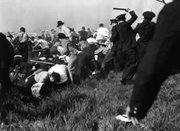In this May 30, 1937, file photo, police using guns, clubs and tear gas wade into marching strikers outside Chicago's Republic Steel plant during violent clashes in the early days of labor union organizations.