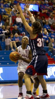 Duquesne forward Samantha Pollino (30) towers over Kansas guard Marisha Brown during Kansas' game against Duquesne Saturday, March 19, 2011 at Allen Fieldhouse. The Jayhawks lost, 80-63, thus eliminating them from the WNIT tournament.
