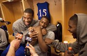 Kansas players Thomas Robinson, left, Elijah Johnson and Josh Selby clown around in the locker room as they debate about which one is a better rapper on Saturday, March 19, 2011 at the BOK Center in Tulsa.