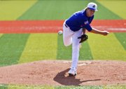 Kansas pitcher Tanner Poppe delivers a pitch during the first game of a doubleheader against Oklahoma State Sunday, March 20, 2011 at Hoglund Ballpark.