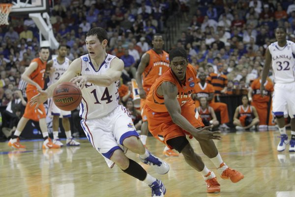 Kansas guard Tyrel Reed runs down a loose ball against Illinois on Sunday, March 20, 2011 at the BOK Center in Tulsa, Okla.