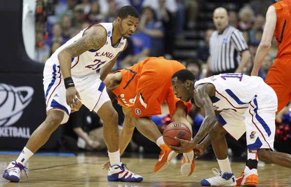 Kansas forward Markieff Morris watches as teammate Tyshawn Taylor comes away with a steal from Illinois guard Demetri McCamey during the first half on Sunday, March 20, 2011 at the BOK Center in Tulsa.